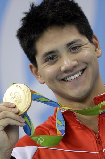 Swimmer who beat Phelps raised by Filipina?