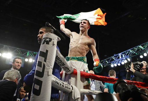 Conlan walks with McGregor, beats Ibarra in pro debut