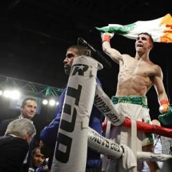 Conlan walks with McGregor, beats Ibarra in pro debut