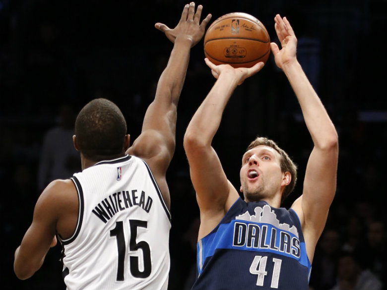 Nowitzki scores 23, leads Mavericks over Nets 111-104