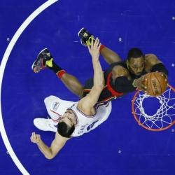 Howard has 22 points, 20 rebounds in Hawks' win over 76ers