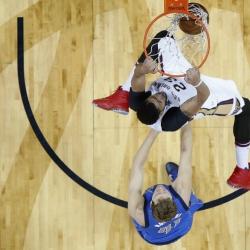 Davis, Cousins lead Pelicans past Mavericks 121-118