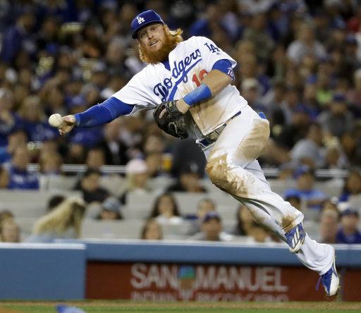 Turner injures right hamstring, Dodgers beat Marlins 7-2