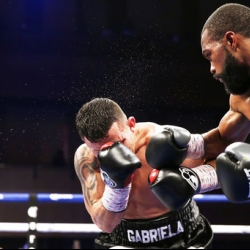 Russell stops Escandon to retain WBC featherweight belt