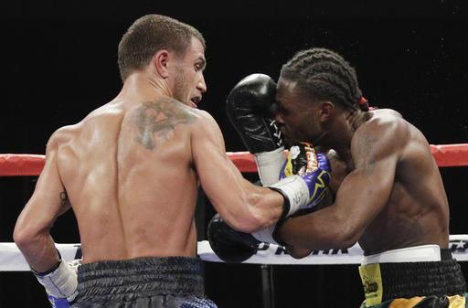 Vasyl Lomachenko defends belt, stops Marriaga after 7 rounds
