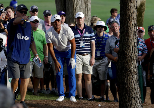 Jason Day makes moves, up and down, during Round 3 at PGA