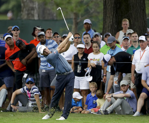 Kisner survives wild finish to take PGA lead
