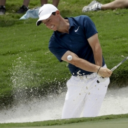 McIlroy feels back pain, not sure when he will play again