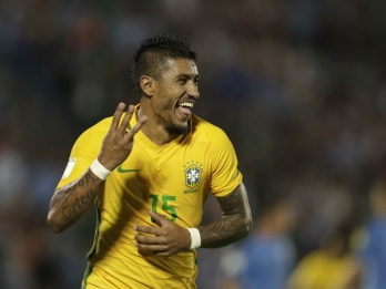 Barca to sign Brazil midfielder Paulinho from Chinese club
