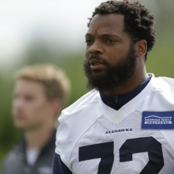 Carroll supports Bennett while saying Seahawks should stand