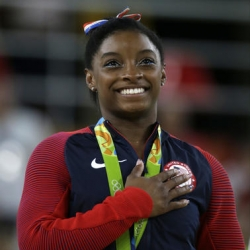 Olympic champ Simone Biles back in gym as she weighs options