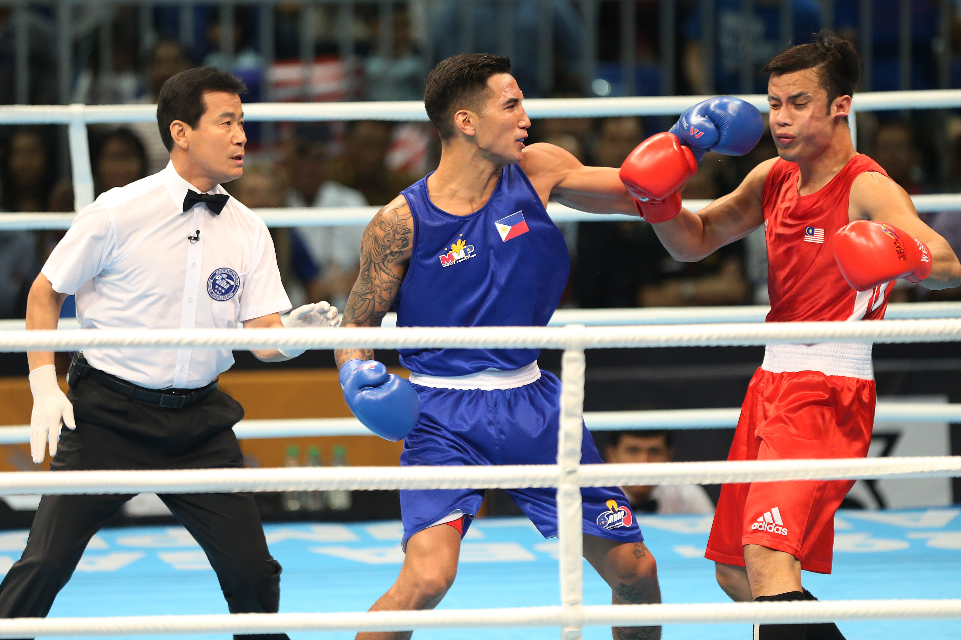 Pinoy boxers Marvin, Marcial score gold in SEA Games