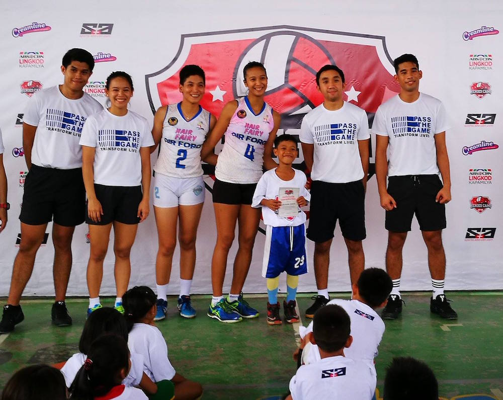 Lady Jet Spikers Iari Yongco, Mickaela Andres give back