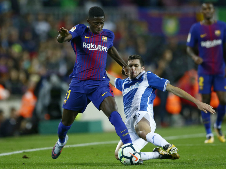 Barcelona's Dembele tears tendon out 3-4 months