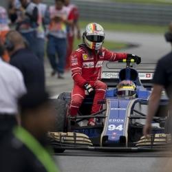 Vettel saves face for Ferrari after Raikkonen's misfortune