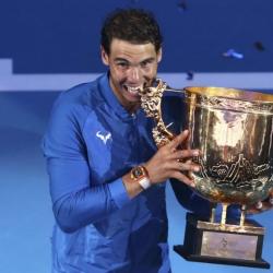 Nadal wins 6th title of year in Beijing; Garcia beats Halep