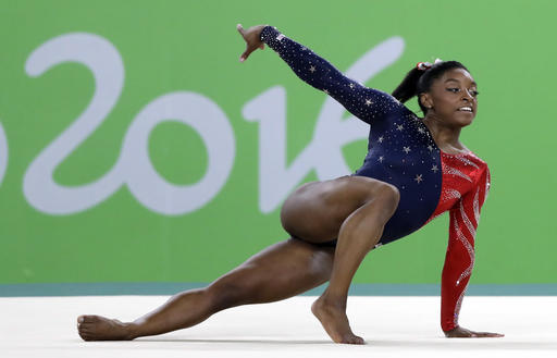 Olympic champion Simone Biles returns to gym with new coach