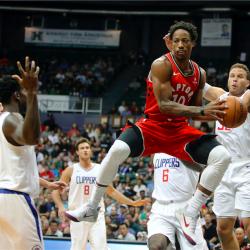DeRozan scores 30 as Raptors rout 76ers 128-94