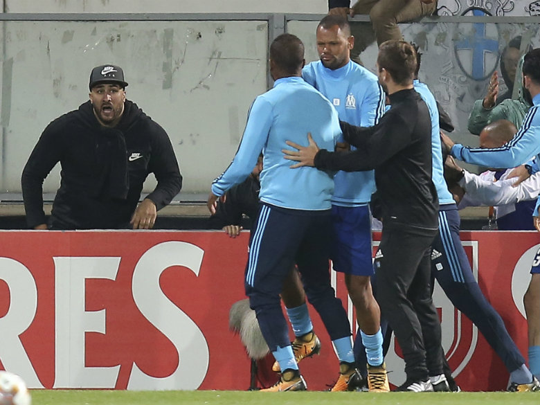 Marseille suspends Evra for kicking fan pending UEFA hearing