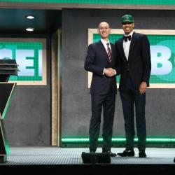 Celtics' Tatum in precautionary walking boot