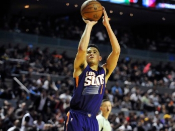 Devin Booker's 33 points power Suns past Lakers, 122-113