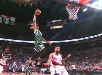 Giannis Antetokounmpo rises for the jam