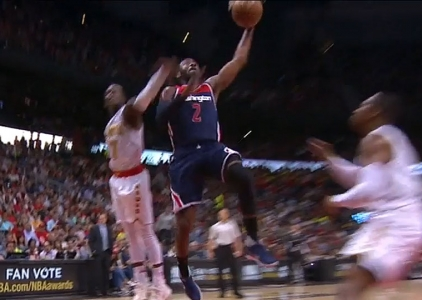 John Wall rises for the jam vs the Hawks