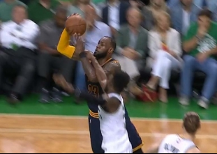 LeBron James scores off a spin move and draws a foul