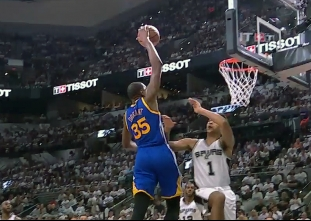 Kevin Durant rises for the jam vs the Spurs