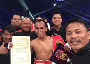 Melindo wins his first wins his first world boxing title