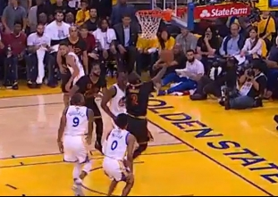 Kyrie Irving uses the crossover to get to the basket for the