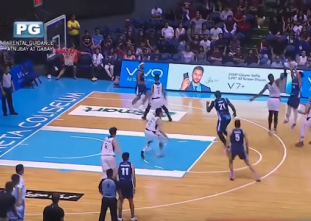 Jerie Pingoy drills tough three pointer over two UP Maroons