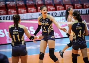 Lady Bulldogs win second straight, take a share of lead